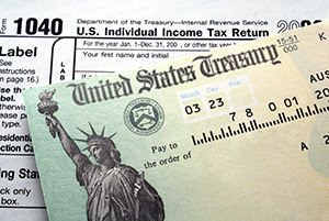 Should you save or invest your tax refund - image